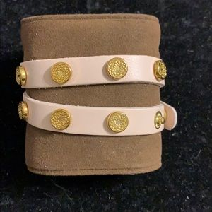 Rose colored bracelet with gold studs